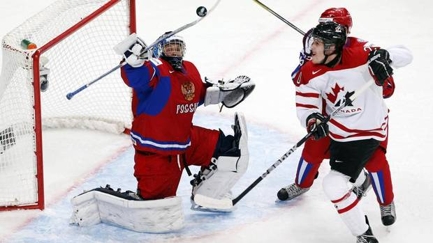 Canada's Brett Ritchie battles for the puck with Russia's goalie Andrei Makarov during the first period (MARK BLINCH/REUTERS)