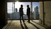 Vice president Shamez Virani, left, president Andrew Hoffman of CentreCourt Developments are photographed at one of their condo developments located at Adelaide and Peter Street in Toronto. (Kevin Van Paassen/The Globe and Mail)