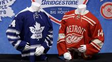 Jerseys to be worn at the NHL Winter Classic hockey game are shown on display in Detroit, Sunday April 7, 2013. (Associated Press)
