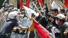 Demonstrators protesting against Greece's austerity measures clash with riot police in Athens, May 4, 2010 (PASCAL ROSSIGNOL)