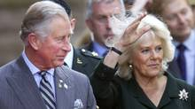 Britain's Prince Charles and his wife Camilla, Duchess of Cornwall, arrive at Queens Park in Toronto May 22, 2012. The Prince of Wales and his wife are on a three-day royal tour of Canada as part of events that mark the Queen's Diamond Jubilee. (FRED THORNHILL/Fred Thornhill/REUTERS)
