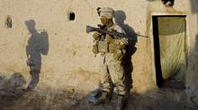 U.S. Marines search a compound in Lakari, in Afghanistan's Helmand province, on November 21, 2009.