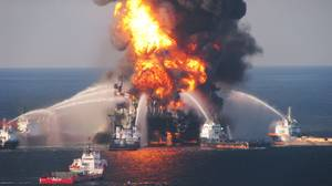 Fire boats battle a fire at the off shore oil rig Deepwater Horizon April 21, 2010 in the Gulf of Mexico off the coast of Louisiana. Multiple Coast Guard helicopters, planes and cutters responded to rescue the Deepwater Horizons 126 person crew after an explosion and fire caused the crew to evacuate.