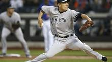 New York Yankees starting pitcher Masahiro Tanaka delivers in the first inning against the New York Mets in a baseball game in New York, Wednesday, May 14, 2014. (AP)