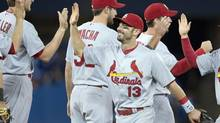St. Louis Cardinals Matt Carpenter (13) celebrates with teammates after defeating the Toronto Blue Jays 5-0 in interleague action in Toronto on Sunday June 8, 2014. (Frank Gunn/THE CANADIAN PRESS)