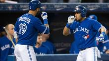 Toronto Blue Jays left fielder Melky Cabrera (53) celebrates a home run with right fielder Jose Bautista (19) during the first inning in a game against the New York Yankees at the Rogers Centre. (USA TODAY Sports)