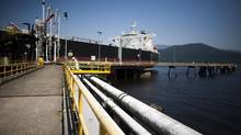 A crude oil tanker arrives at the Kinder Morgan Westridge marine terminal in Burnaby, B.C., alongside various pipes leading to B.C. from Alberta, in July 2012. (Rafal Gerszak for The Globe and Mail)