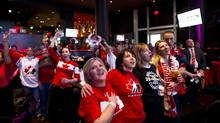 A few of the Canadian fans who were able to watch and celebrate a gold medal at Real Sports Bar in Toronto as Canada defeated the United States in women's hockey at the Sochi Olympics on Feb. 20, 2014. (Kevin Van Paassen/The Globe and Mail)