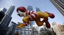 The Ronald McDonald balloon makes its way along the Macy's Thanksgiving Day Parade in New York (BRENDAN MCDERMID/REUTERS)