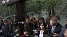 Eileen Mohan, middle, talks to reporters outside the courthouse during a break at the Surrey Six Trial in Vancouver, September 30, 2013. Her son Chris was one of two innocent bystanders killed during a gangland style shooting related to British Columbia's violent drug trade in 2007. (ANDY CLARK/REUTERS)
