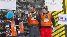 In this image provided by Nathan Bilow Photography, from left to right, Canada's Maelle Ricker and Dominique Maltais, who won the women's event, and United States' Seth Wescott and Nate Holland, who won the men's snowboard cross team World Cup event, celebrate on the podium in Telluride, Colo., Saturday, Dec. 15, 2012. (Nathan Bilow/AP)