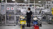 Employees at Magna plant Dortec Industries in Markham, Ont., Feb 19, 2013. (Moe Doiron/The Globe and Mail)
