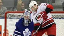 Toronto Maple Leafs goaltender James Reimer makes a save on Carolina Hurricanes left winger Sergei Samsonov (14) during second period NHL hockey action in Toronto on Thursday February 3, 2011. The Hurricanes have acquired defenceman Bryan Allen from the Florida Panthers in exchange for winger Samsonov. (Frank Gunn)