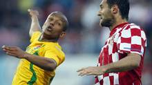 Wales' Robert Earnshaw, left, is challenged by Croatia's Josip Simunic (Darko Bandic/The Associated Press)