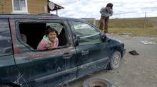 Children play on a beat-up old minivan in Kashechewan, where most of the residents are on welfare and the birth rate is triple the national average. (Alexandra Shimo for The Globe and Mail/Alexandra Shimo for The Globe and Mail)