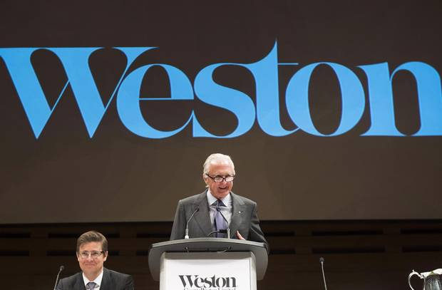 W. Galen Weston speaks alongside his son and new director Galen Weston at the company's annual general meeting in Toronto on Tuesday, May 10, 2016.