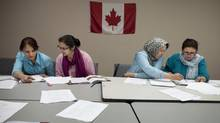 Under new rules that will take effect next year, workers aged between 18 and 36 will be the most coveted under the Federal Skilled Worker Class of immigrants. The government says the change is based on clear evidence that older immigrants are much less likely to succeed in the work force. (Moe Doiron/The Globe and Mail)