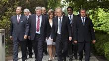 Quebec Liberal Party Leader Jean Charest, centre, walks with candidates, on his way to his office following a news conference Tuesday, August 14, 2012 in Quebec City. (Jacques Boissinot/THE CANADIAN PRESS)