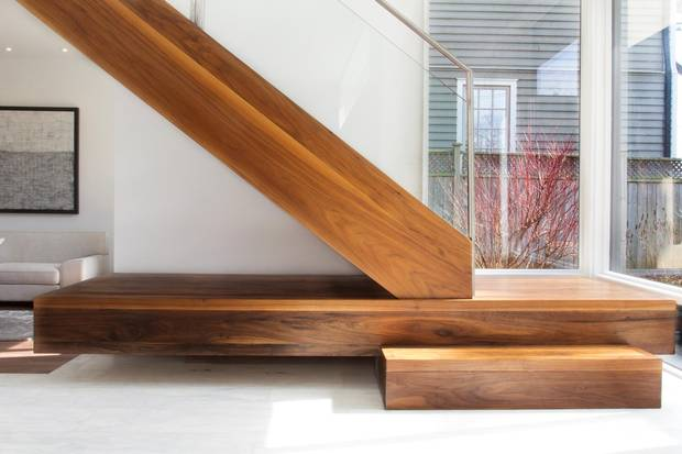 A larger step on the main staircase adds functionality and interest to the home's design.