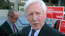 Liberal foreign affairs critic Bob Rae talks to reporters while campaigning in Calgary on April 11, 2011. (Bill Graveland/THE CANADIAN PRESS)
