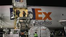 Workers load an aircraft at a FedEx facility at O'Hare Airport on December 12, 2011 in Chicago. (Scott Olson/Scott Olson/Getty Images)