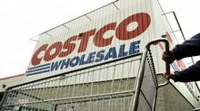 A shopper pushes a cart outside Costco Wholesale in Danvers, Mass. in this May 27, 2009 file photo. (ELISE AMENDOLA/THE ASSOCIATED PRESS)