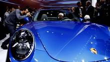 Members of the media approach the front end of a Porsche 911 Targa during the press preview day of the North American International Auto Show in Detroit, Michigan January 13, 2014. (Joshua Lott/Reuters)