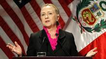 U.S. Secretary of State Hillary Clinton, at a conference in Peru, blames 'the fog of war' for the evolving account of the terror attack in Libya that killed four Americans in September. (MARIANA BAZO/REUTERS)