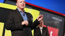 Microsoft CEO Steve Ballmer speaks as Nokia CEO Stephen Elop (behind) looks on at a Nokia phone launch, with Microsoft's Windows 8 operating system in New York, September 5, 2012. (BRENDAN MCDERMID/REUTERS)