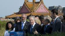 Jean Charest is flanked by candidates during a news conference on Thursday. (Paul Chiasson/THE CANADIAN PRESS)