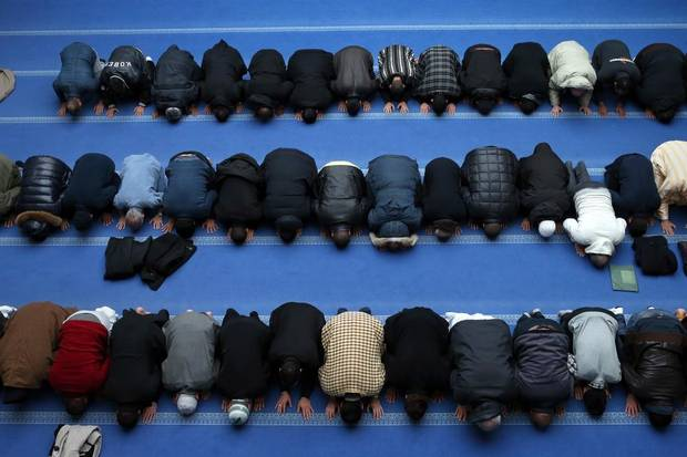 French Muslims pray at the mosque in Gennevilliers, a suburb north of Paris, on Jan. 8, 2015.