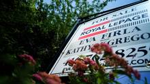 A real estate sign on a lawn in Toronto. (Sami Siva/THE GLOBE AND MAIL)