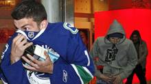 Vancouver Canucks fans loot merchandise through the smashed windows of a Sears store during a riot in reaction to their team's loss to the Boston Bruins in Game 7 of the NHL Stanley Cup final hockey game in Vancouver, British Columbia June 15, 2011. (MIKE CARLSON/REUTERS)