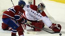 Washington Capitals' goalie Michal Neuvirth (R) makes a save against Montreal Canadiens' Erik Cole during second period NHL hockey action in Montreal January 18, 2012. (CHRISTINNE MUSCHI/REUTERS)