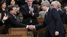 Finance Minister Jim Flaherty shakes hands with Prime Minister Stephen Harper in the House of Commons on Parliament Hill in Ottawa March 22, 2011. (CHRIS WATTIE/REUTERS/CHRIS WATTIE/REUTERS)