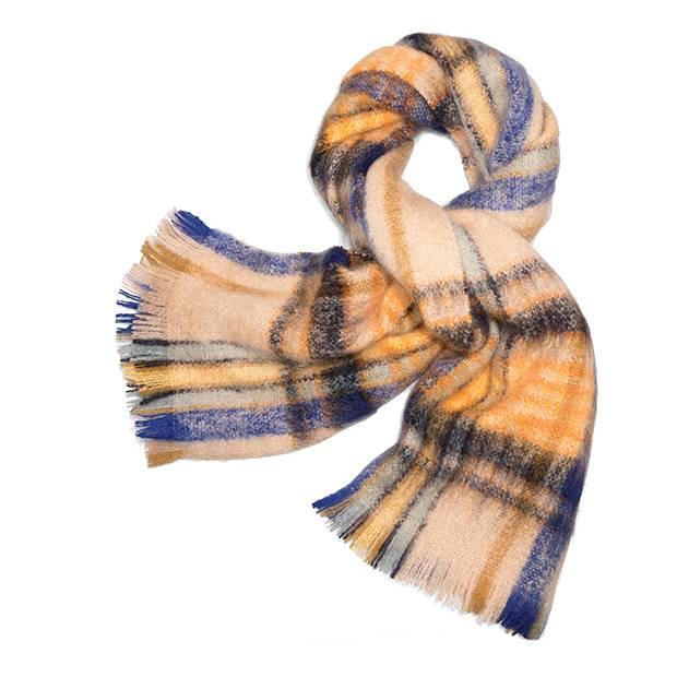 Shetland scarf, $298 (U.S.) at Tory Burch (www.toryburch.com).