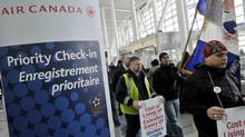 Air Canada employees walk through Terminal 1 during a one hour protest at Pearson International airport in Toronto, March 9, 2012. (J.P. MOCZULSKI/J.P. MOCZULSKI for The Globe and Mail)