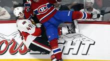 Ottawa Senators' Fredrik Claesson, of Sweden, is checked by Montreal Canadiens' Lars Eller, of Denmark, during third period NHL preseason action in Montreal on Thursday, September 26, 2013. (Ryan Remiorz/THE CANADIAN PRESS)