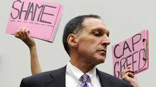 Protesters at Congressional hearings last year jeer former Lehman Brothers CEO Richard S. Fuld, who walked away from the largest bankruptcy in U.S. history with millions in compensation. (JONATHAN ERNST)