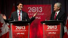 Justin Trudeau, left, and Marc Garneau exchange views at the Liberal leadership debate in Halifax, March 3, 2013. (Andrew Vaughan/THE CANADIAN PRESS)