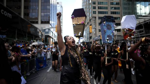 Members of Black Lives Matter Toronto take part in the annual Pride Parade in Toronto on Sunday, July 3, 2016.