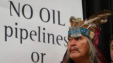Chief Martin Louie, of the Nadleh Whut'en First Nation, looks on during a signing ceremony of a declaration opposing a crude oil pipeline and tanker expansion in Vancouver, B.C., on Thursday December 1, 2011. (Darryl Dyck/ The Canadian Press/Darryl Dyck/ The Canadian Press)