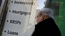 Signs advertise RRSPs and other investments in downtown Toronto. (Peter Power/Peter Power/The Globe and Mail)