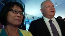 Mayoral contender Olivia Chow with Councillor Doug Ford at Toronto City Hall, June 10, 2014. (Elizabeth Church/The Globe and Mail)
