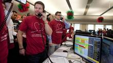 Mark Wahlberg takes donations during CIBC Miracle Day on CIBC's trading floor in Toronto on Wednesday, Dec. 5, 2012. (Matthew Sherwood/Matthew Sherwood for The Globe a)