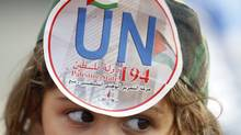 "A Palestinian girl wearing a replica of a military uniform bears a sticker on her forehead, which reads: ""UN 194 Palestinian State"", during a rally in support of Palestinian President Mahmoud Abbas' bid for statehood recognition at the United Nations, at Mar Elias refugee camp in Beirut September 23, 2011. (SHARIF KARIM/REUTERS)"
