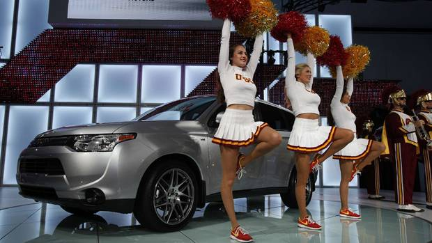 Members of the USC marching band perform during the unveiling of the 2014 Mitsubishi Outlander at the 2012 Los Angeles Auto. (MARIO ANZUONI/REUTERS)