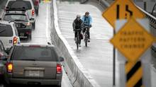 Cyclists rides across the new two-way bike lane separated from traffic on the Dunsmuir Viaduct in Vancouver March 10, 2010. (John Lehmann/The Globe and Mail/John Lehmann/The Globe and Mail)