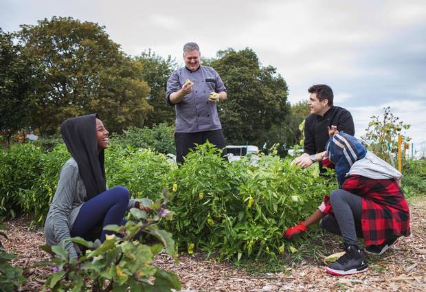 Aisha Mahamed, Alia Mahamed and Ryan Rideout work in the school garden with chef Keith Hoare at Thistletown Collegiate in Etobicoke on October 6, 2017.
