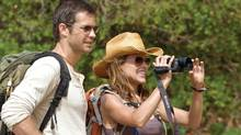 Nick (Timothy Olyphant) and Gina (Kiele Sanchez) observe their surroundings in a paradise that becomes hell on earth as a brutal battle for survival begins in A Perfect Getaway. (Photo Credit: Javier Pesquera //Copyright: © 2009 Rogue Pictures. ALL RIGHTS RESERVED.)